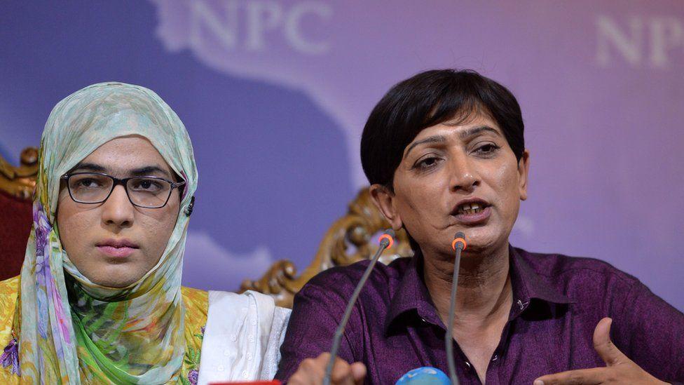 Transgender election candidates Nayyab Ali (L) and Nadeem Kashish speak at a news conference in Islamabad, 5 July 2018