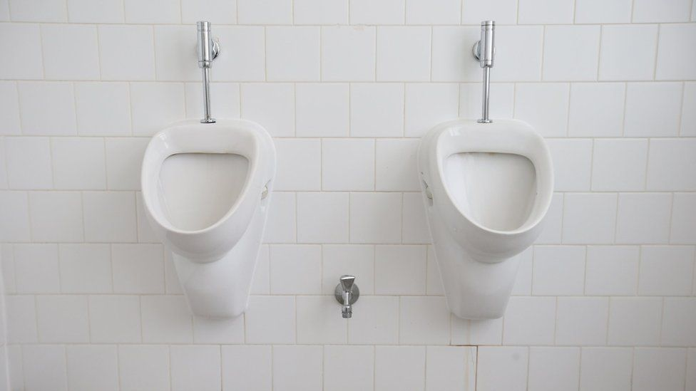 Urinals hang on a wall in a gender-neutral toilet at the office building of the city's Senate Administration for Work, Integration and Women on November 24, 2015 in Berlin, Germany