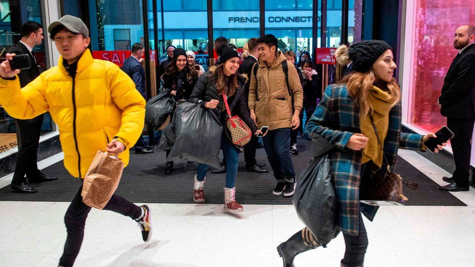 Shoppers running into Selfridges in London as the doors open