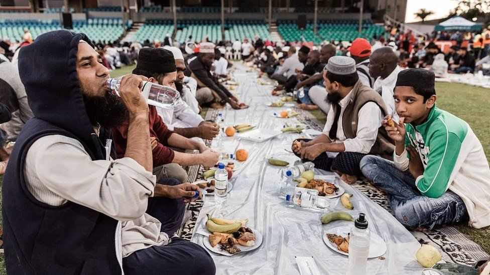 Muslims breaking Ramadan fast with ceremonial meal iftar