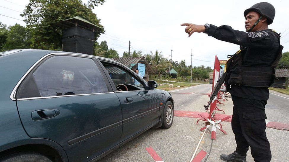 A car stops at a checkpoint in Narathiwat province.