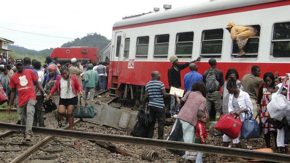 Survivors leaving a train crash site in Cameroon.