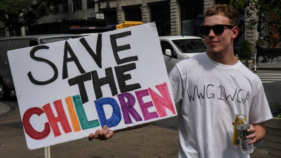 """A person wears a t-shirt with the anagram WWG1WGA, the QAnon slogan, while participating in a """"save the children"""" march and rally in New York City, New York, U.S. August 12, 2020"""