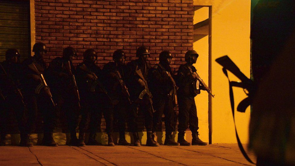 """Burkina Faso""""s soldiers take position in the surroundings of the hotel Splendide and the cafe Cappuccino during an attack on both the hotel and cafe by Al-Qaeda linked gunmen"""