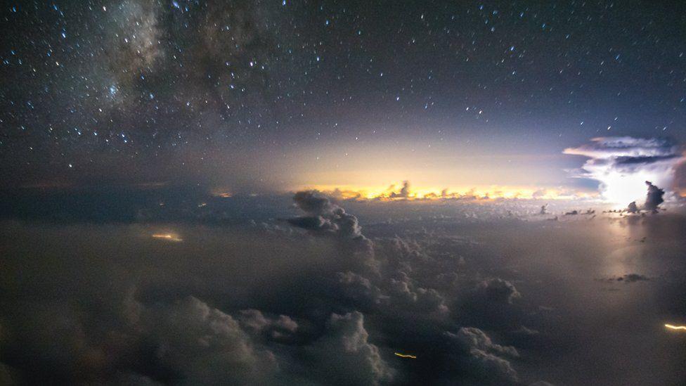 Glow of the sun among dark clouds