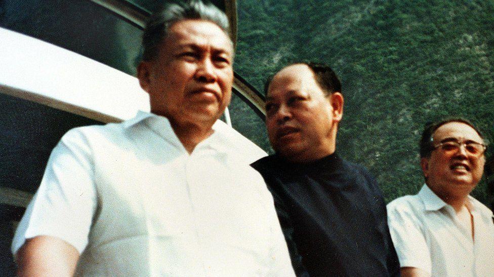 Pol Pot (left) in Cambodia in late 1970s