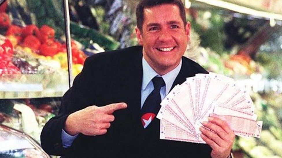 """Dale Winton doing a """"Supermarket Sweep"""" in 1997 to promote the National Lottery"""