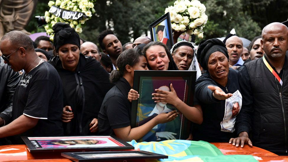 Relatives mourn next to the coffins of Ethiopian passengers and crew members, during a memorial service for the victims of the Ethiopian Airlines Flight ET 302 plane crash, at the Selassie Church in Addis Ababa, Ethiopia March 17, 2019.