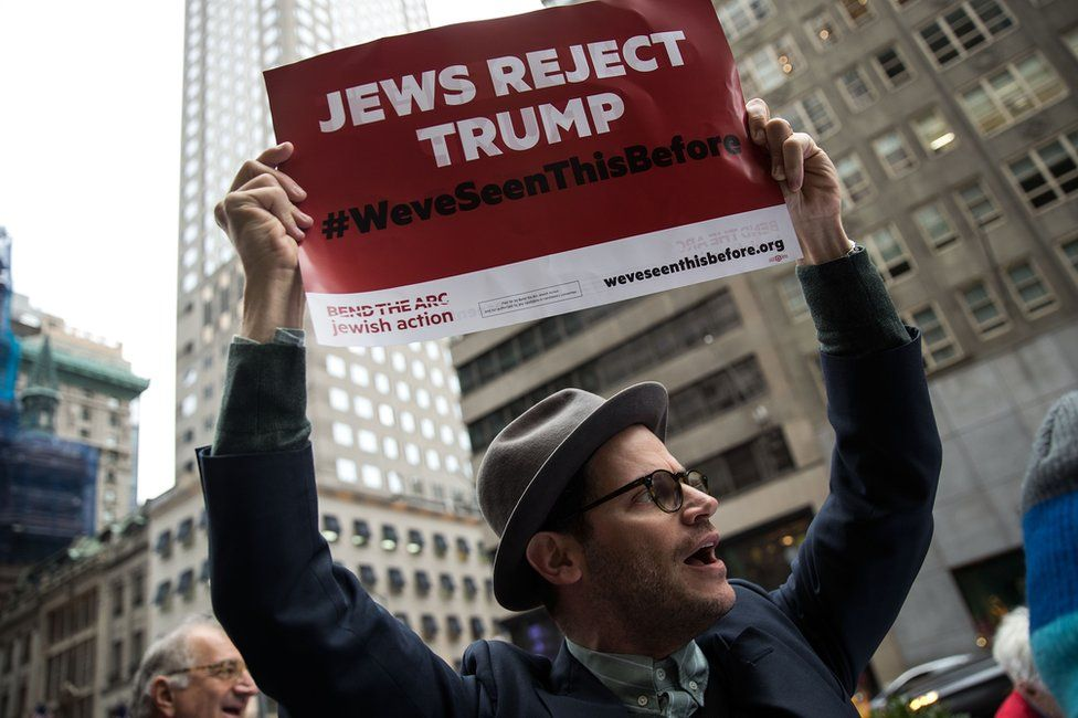 Protestors and members of a Jewish social action group rally against what they call hateful and violent rhetoric from Republican presidential candidate Donald Trump, outside of Trump Tower on Fifth Avenue, September 29, 2016 in New York City