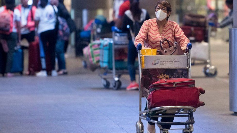 woman wearing mask in airport