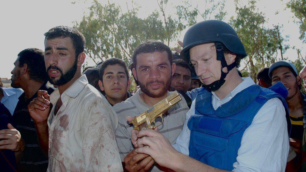 Gabriel Gatehouse holds the golden gun in 2011