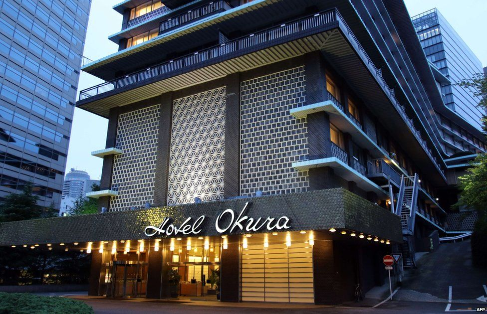"""This picture taken on 29 August 2015 shows an entrance to the main building of Japan""""s iconic Hotel Okura in Tokyo."""