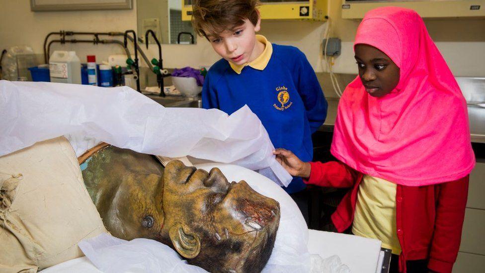 Children examining a Frankenstein head