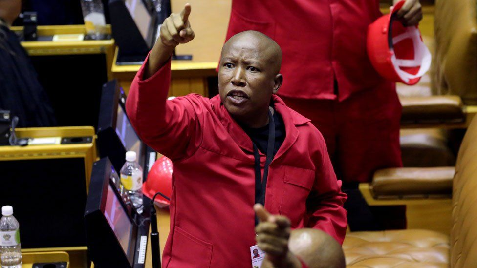 Opposition Economic Freedom Fighters (EFF) party leader Julius Malema objects as South African President Cyril Ramaphosa attempts to deliver his State of the Nation address at parliament in Cape Town,