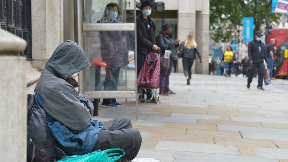 Homeless person sleeping near Charing Cross Station, London, June 2021