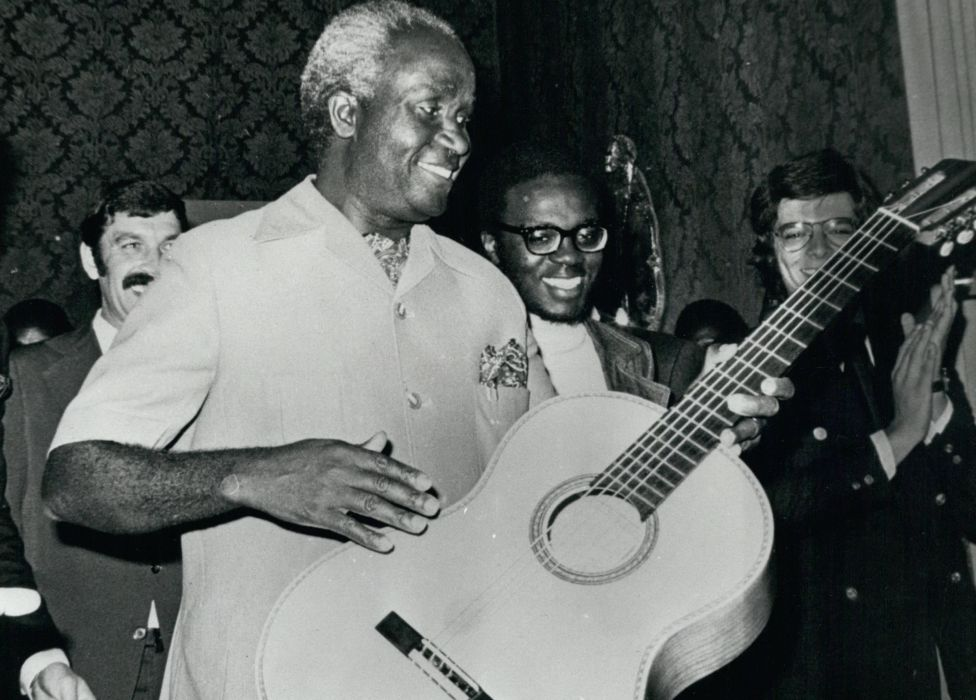 Zambia's President Kaunda playing the guitar on a visit to Portugal in 1975