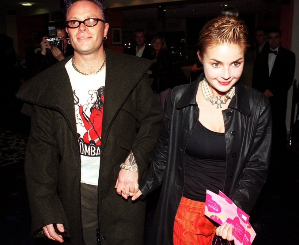 Keith Flint and Gail Porter walking hand-in-hand