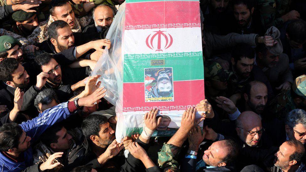Mourners carry the coffin of Brigadier General Mohammad Ali Allahdadi in Tehran