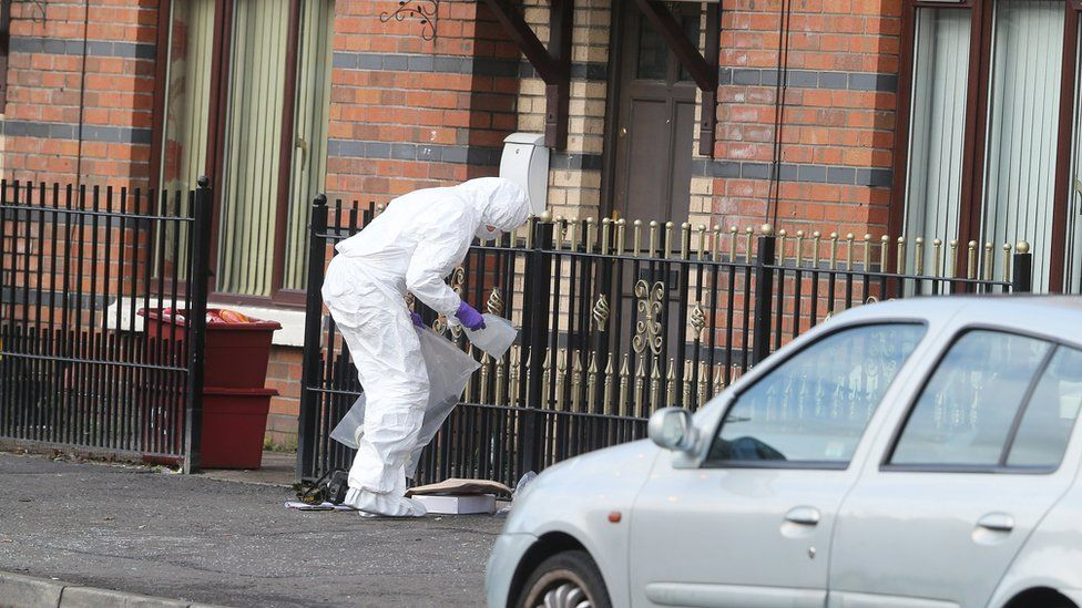 A police forensics officer at the scene of the security alert