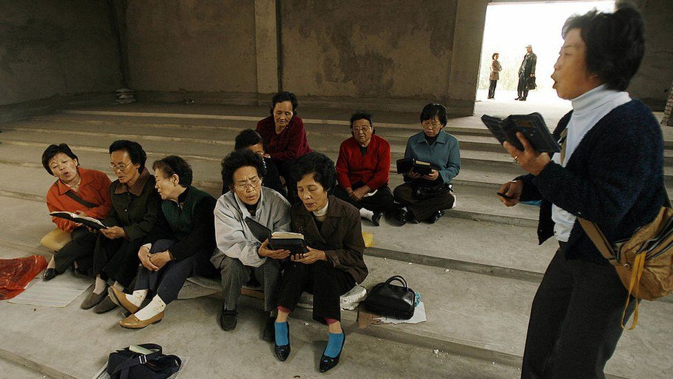 Ethnic Korean Christians sing hymns in their half-finished church in the town of Yanji in Yanbian Korean Autonomous Prefecture on the China/North Korea border