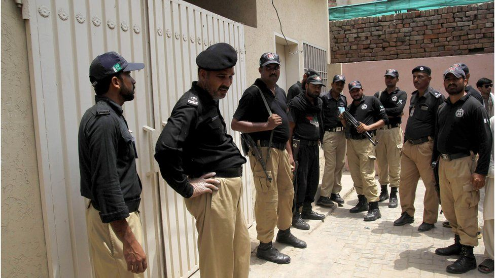 Pakistani policemen outside Qandeel Baloch's house following her murder