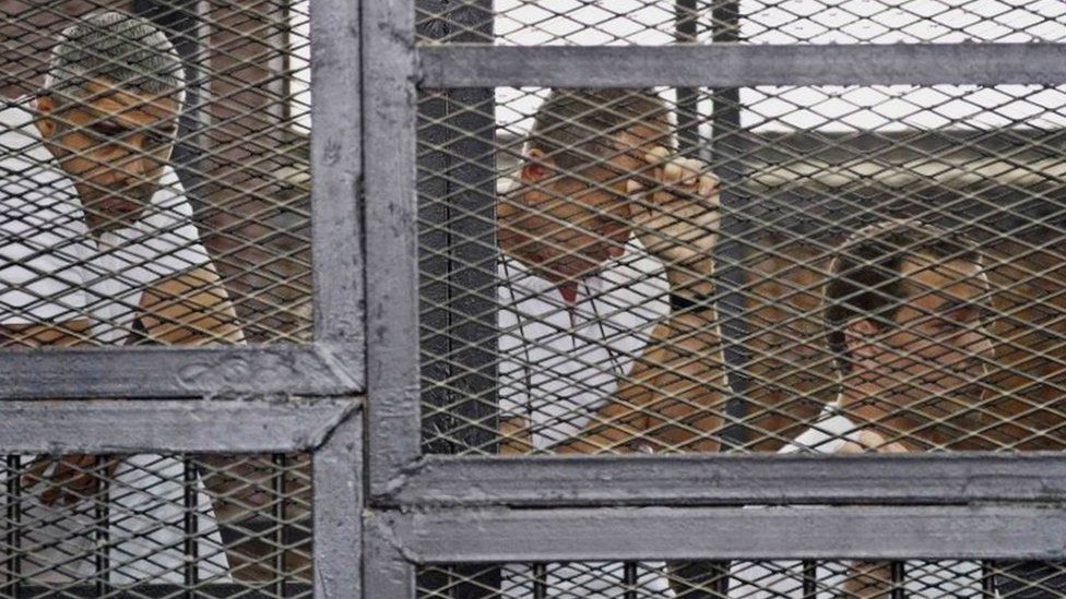Mohammed Fahmy (left), Peter Greste (centre) and Baher Mohamed in court in Cairo (May 2014)