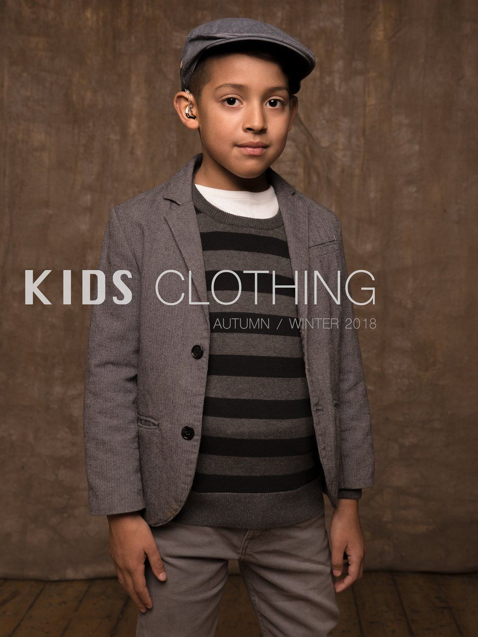 Santiago Ospina Lozada in a fashion shoot with hearing aid