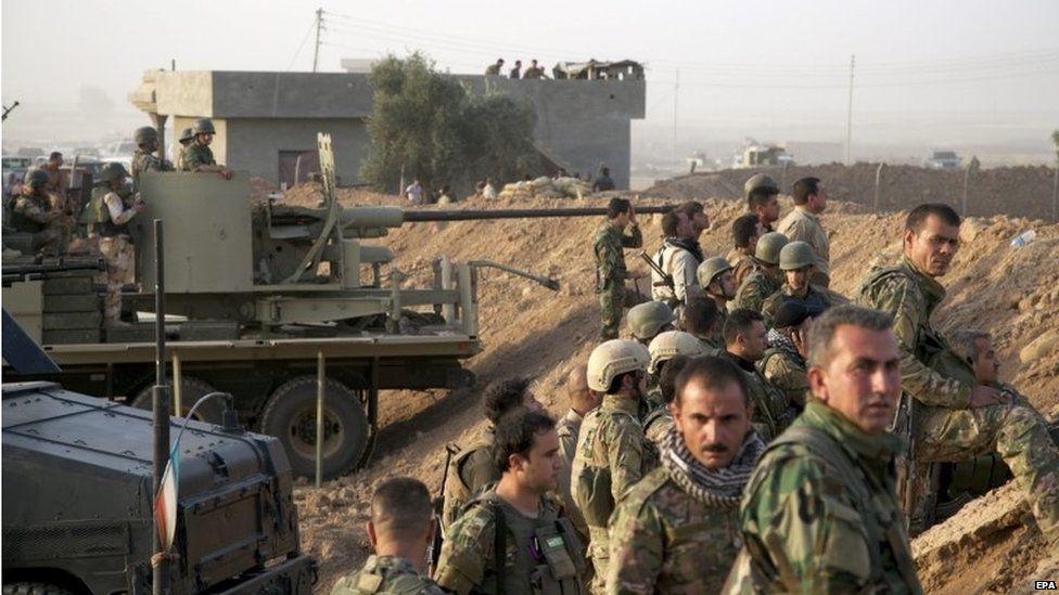 Kurdish Peshmerga soldiers take up positions, south of Kirkuk, northern Iraq, 06 July 2015