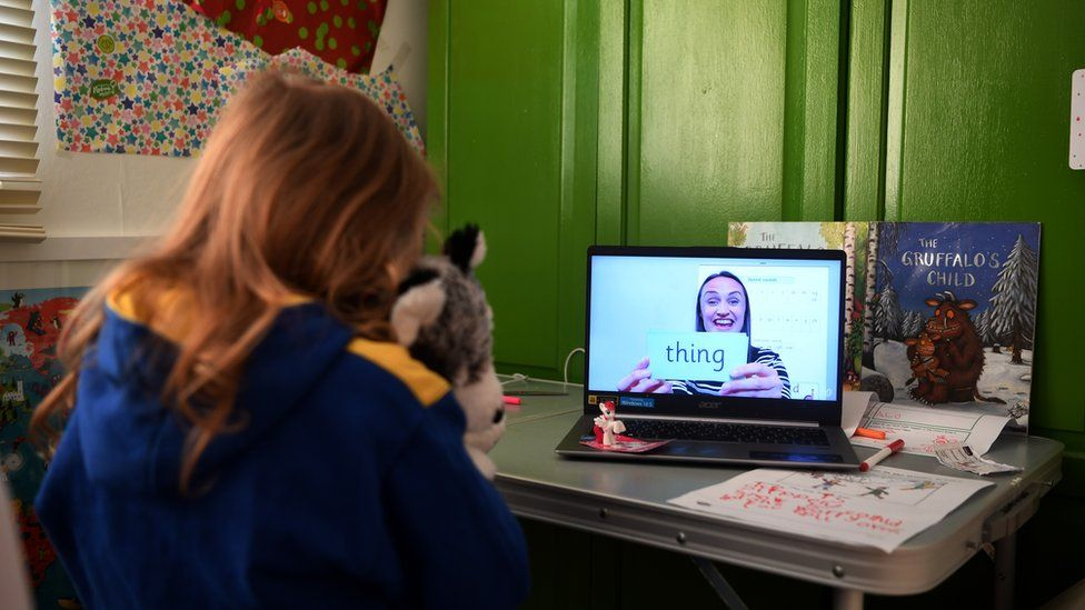 Schoolgirl takes part in an English lesson from home