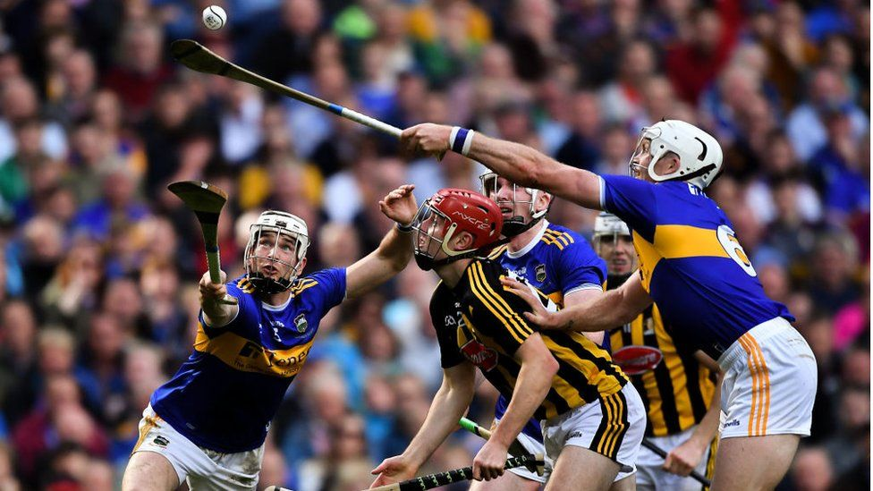 Tipperary players Brendan Maher, left, and Padraic Maher, right, try to gather possession as James Maher of Kilkenny looks on during the GAA Hurling All-Ireland Senior Championship Final match between Kilkenny and Tipperary at Croke Park in Dublin