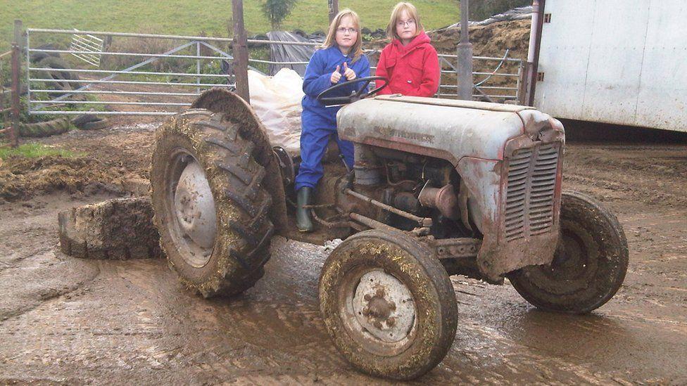 Anna and Laura Callwood as children on the family farm