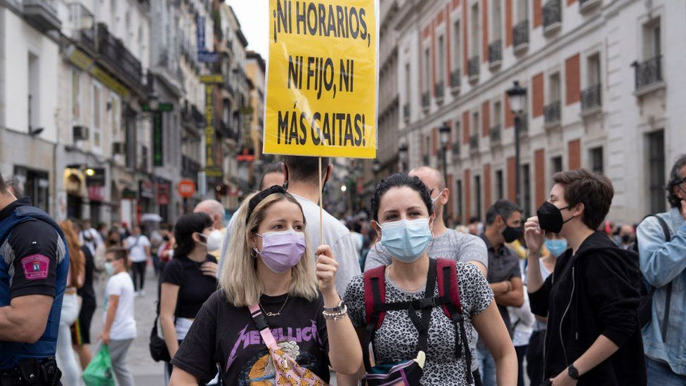 People protesting with banners during a demonstration against the new rise in the electricity bill approved by the government, in Madrid, Spain, on June 5, 2021