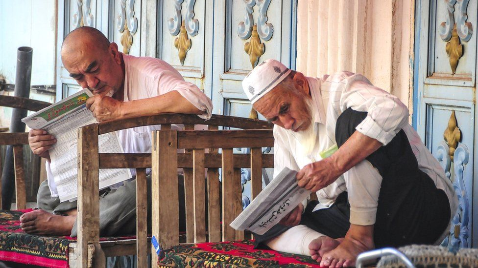 Uighur people in China's Xinjiang Uighur Autonomous Region's Kashgar city, 7 July 2015