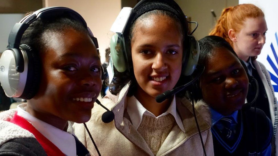 Girls at the camp wearing headsets