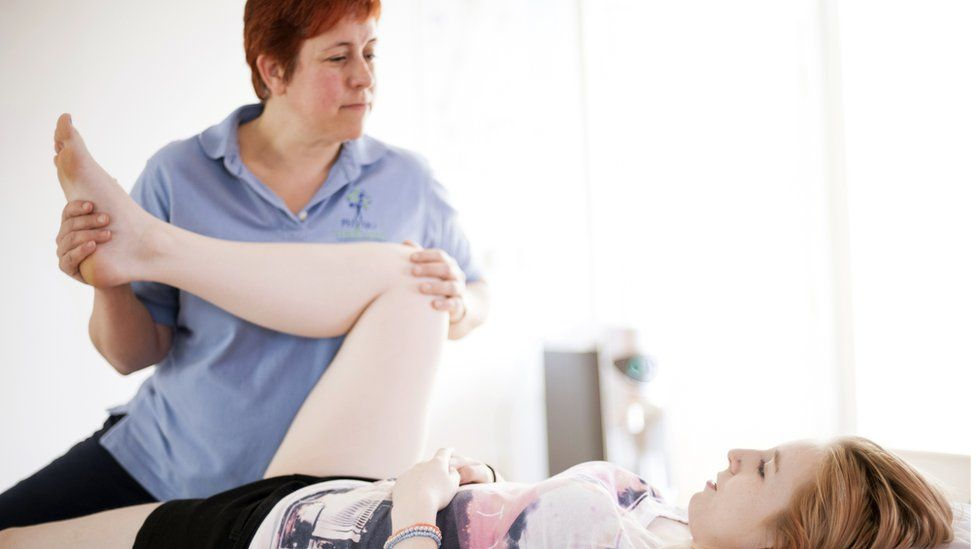 Physio working on a woman's leg