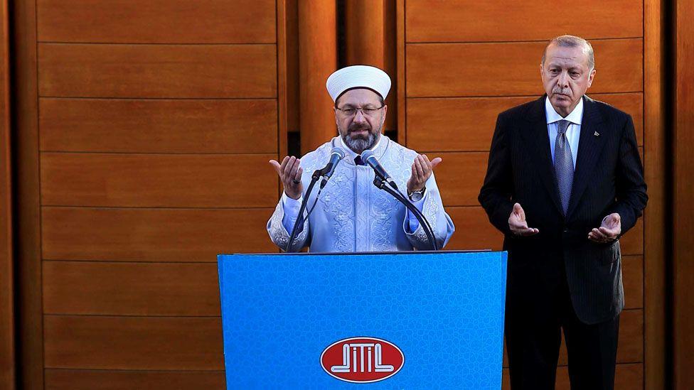Turkish President Recep Tayyip Erdogan (R) stands next to the President of Religious Affairs of Turkey Ali Erbas