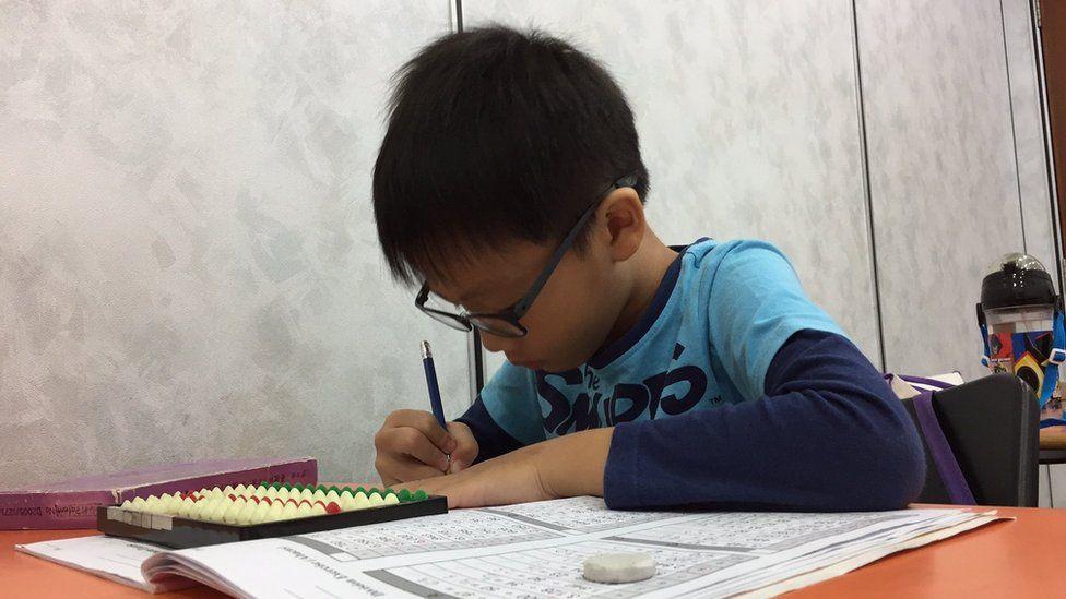 Child practising arithmetic
