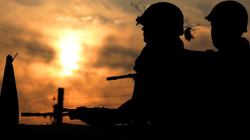 Silhouette of soldiers in Kashmir