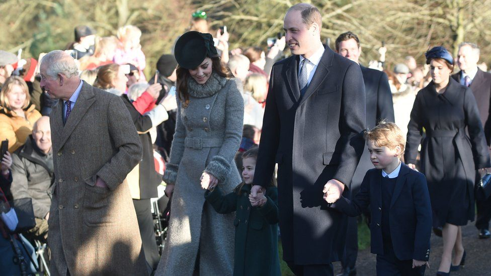 The Prince of Wales with the Duke and Duchess of Cambridge and their children Prince George and Princess Charlotte