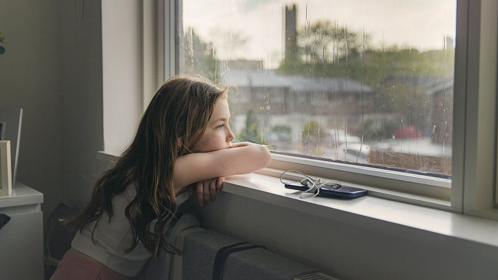 A girl looking out of a window
