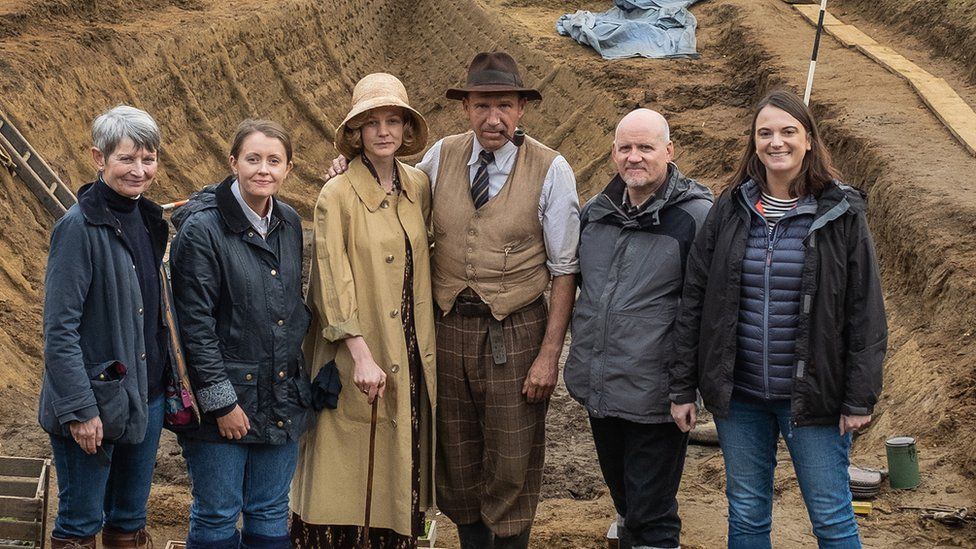 National Trust team with actors Carey Mulligan and Ralph Fiennes (centre)