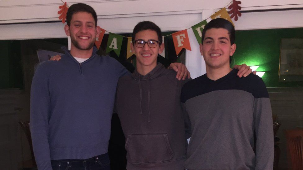 Josh Fidel (centre) pictured with his brothers Matt (left) and Noah (right)