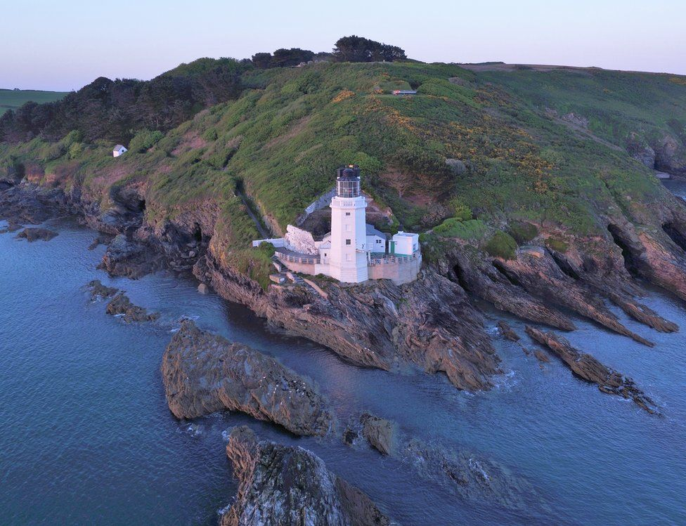 An aerial view of a lighthouse