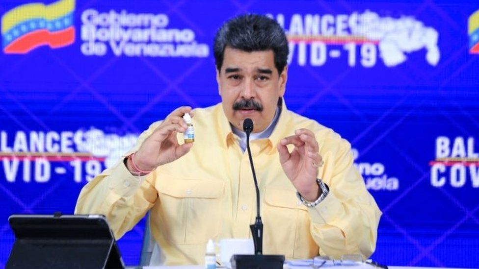 """Nicolás Maduro holds up his unproven herbal remedy """"cure"""""""