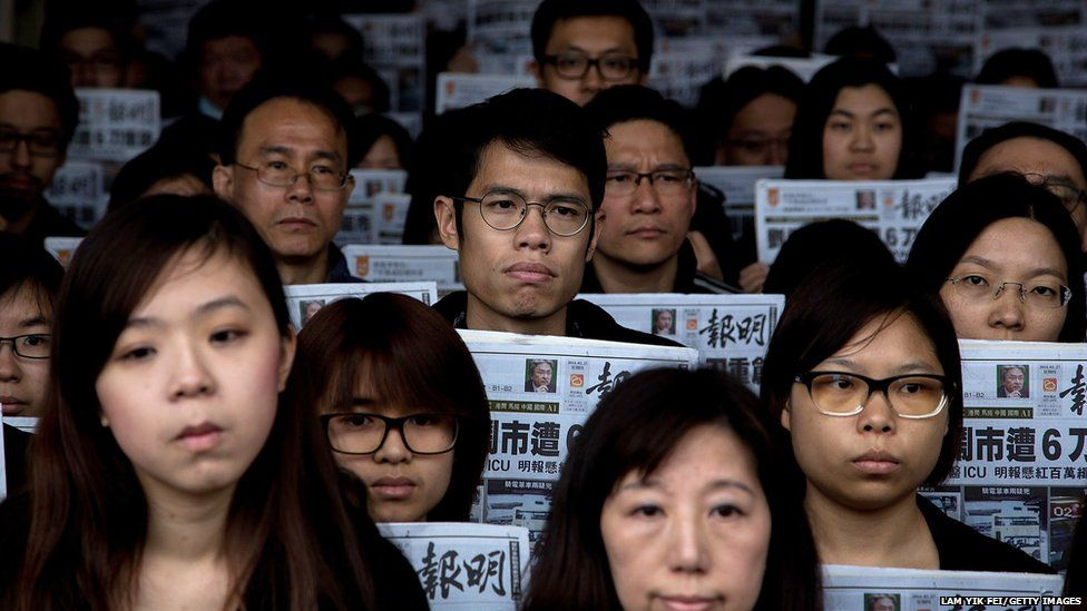 Staff members of Ming Pao protest against the attack on Mr Lau