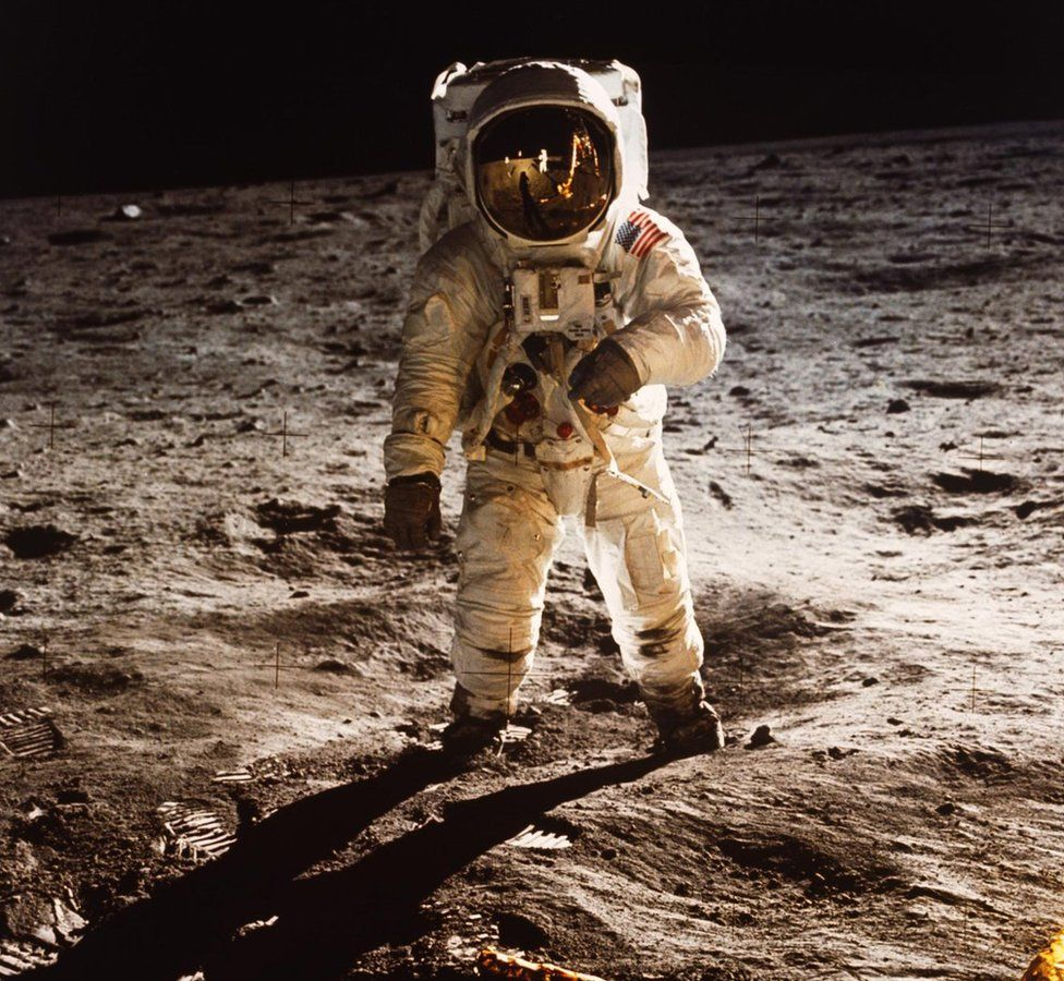 """Astronaut Buzz Aldrin walks on the surface of the Moon near the leg of the Lunar Module (LM) """"Eagle"""" during the Apollo 11 mission, 20 July 1969"""