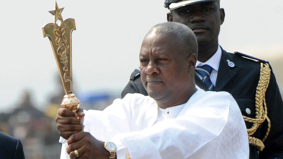 President Mahama raises a staff during his inauguration on 7 January, 2013.