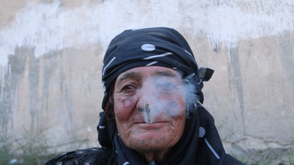 A woman is shown smoking - one of many interdictions under IS