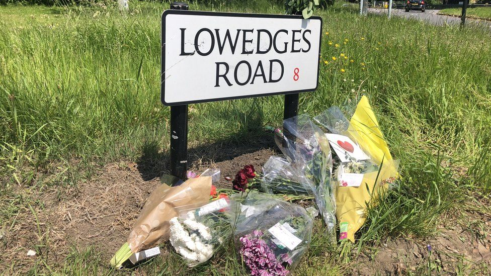 Floral tributes have been left on Lowedges Road