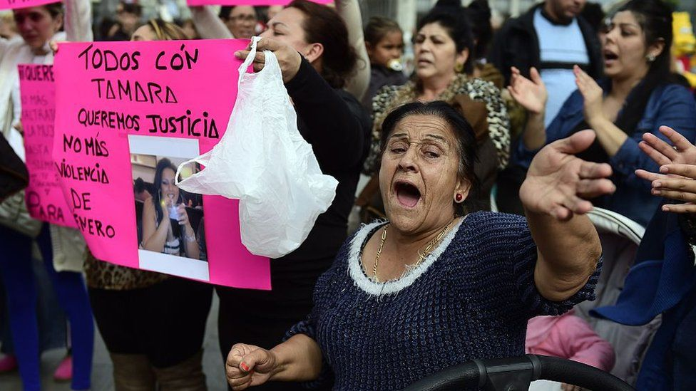 Gypsy community members hold placards reading, 'Justice for Tamara', during a protest to mark the death of Tamara Simon Barrul and against domestic violence, in Madrid on 10 April 2015